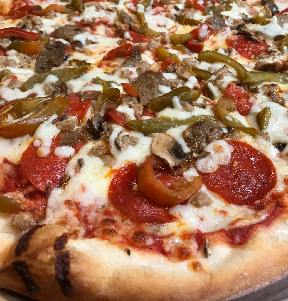 Our signature New York Style Meat Lovers Pizza.
