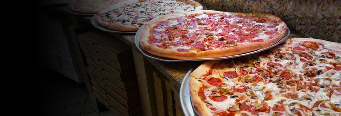 Four delicious new york style pizzas fresh out of the oven.